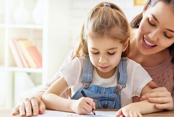 Working parent spends time with her child who is drawing